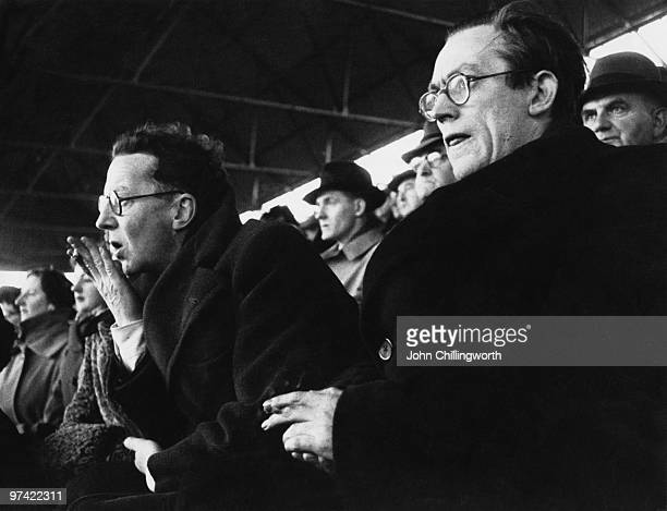 MP for Plymouth Devonport and Plymouth Argyle supporter Michael Foot watches his team play Huddersfield Town at Home Park Plymouth January 1953 With...