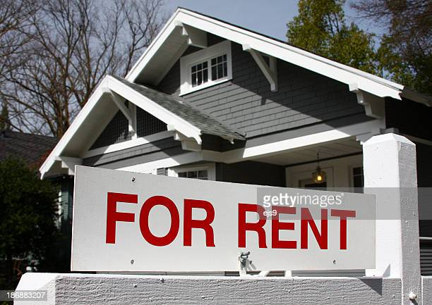For Rent California real estate sign and house