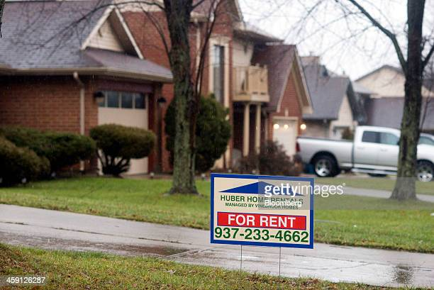 A 'For Rent' sign by Huber Home Rentals Managed by Vinebrook Homes sits in the front yard of a rental property in Huber Heights Ohio US on Saturday...