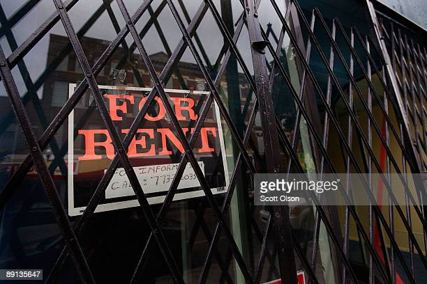 A 'For Rent' sign hangs in a vacant store window along Milwaukee Avenue in the Wicker Park neighborhood July 21 2009 in Chicago Illinois The retail...