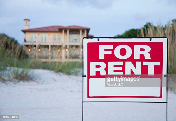 For rent sign in front of beach house
