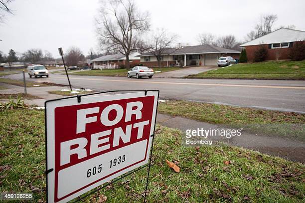 A 'For Rent' sign sits in the front yard of a home in Huber Heights Ohio US on Friday Dec 20 2013 The 38000 residents of Huber Heights are in the...