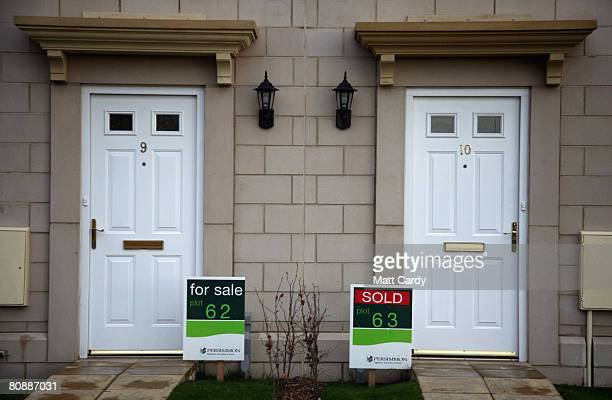 'for sale' and 'sold' signs are displayed outside new build houses on a housing estate by developer and housebuilder Persimmon on April 27 2008 in...
