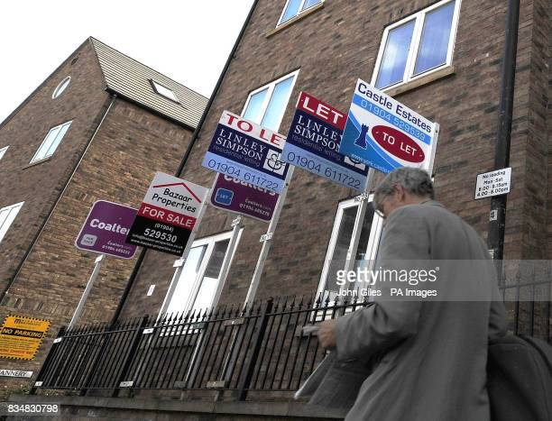 For sale and to let boards on a street in York as house prices dived at a record rate during the year to the end of September losing 124% of their...