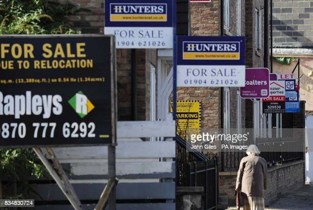For sale boards on a street in York as house prices dived at a record rate during the year to the end of September losing 124% of their value figures...