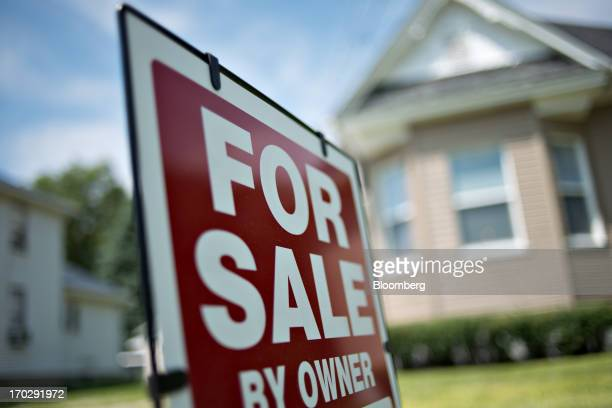 A 'for sale by owner' sign stands outside a home in LaSalle Illinois US on Friday June 7 2013 The Mortgage Bankers Associations weekly mortgage...