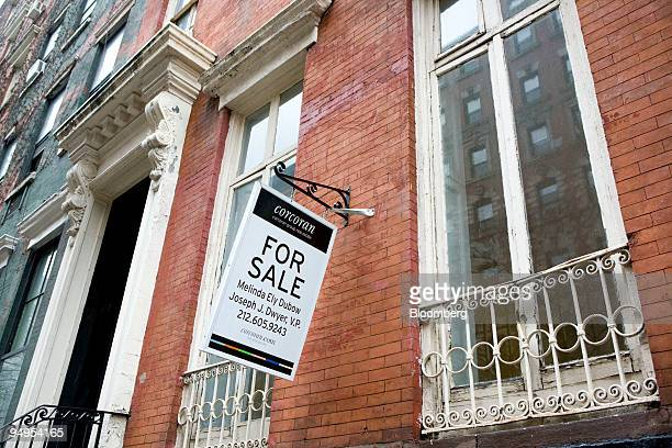 A for sale sign hangs on an apartment building in New York US on Thursday March 19 2008 Manhattan apartment sales declined 23 percent last year as...