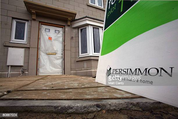 A 'for sale' sign is displayed outside a new build house on a housing estate by developer and housebuilder Persimmon on April 27 2008 in Bath England...
