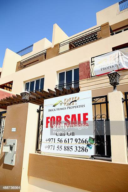 A 'For Sale' sign is displayed outside a residential property in Jumeirah Village Circle on September 15 2015 in Dubai United Arab Emirates
