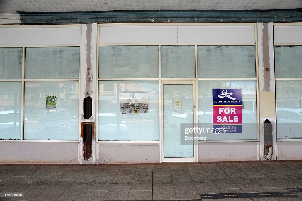 A 'For Sale' sign is displayed outside a shuttered commercial space in the mining town of Kalgoorlie, Australia, on Thursday, Aug. 8, 2013. Western Australia, the nation's largest state by area with 2.6 million square kilometers (1 million square miles) of land, earned A$97 billion from minerals and energy sales in 2012, down from A$108 billion in 2011, according to government figures. Photographer: Carla Gottgens/Bloomberg via Getty Images