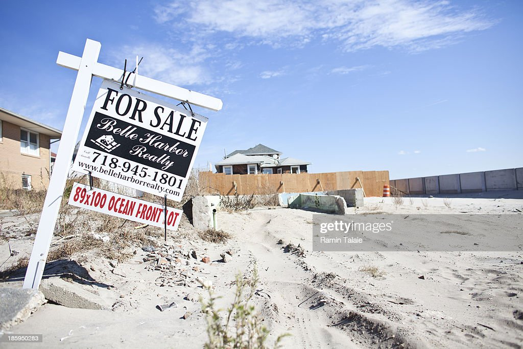 A for sale sign is placed in a beach front property where a house used to stand prior to being washed away by Hurricane Sandy on October 26, 2013 in the Queens borough of New York City. Hurricane Sandy made landfall on October 29, 2012 near Brigantine, New Jersey and affected 24 states from Florida to Maine and cost the country an estimated $65 billion.