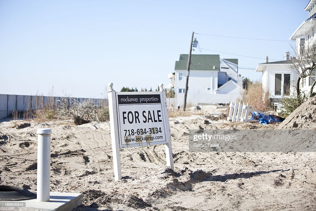 A for sale sign is placed in a lot where a house used to stand prior to being washed away by Hurricane Sandy on October 26, 2013 in the Belle Harbor section in the Queens borough of New York City. Hurricane Sandy made landfall on October 29, 2012 near Brigantine, New Jersey and affected 24 states from Florida to Maine and cost the country an estimated $65 billion.