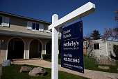 A for sale sign is posted in front of a home for sale on February 23 2015 in San Rafael California According to the National Association of Realtors...