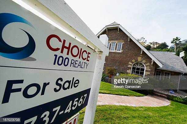 A 'For Sale' sign is posted in front of a house on November 27 2012 in Los Angeles California According to SP Index reports for the month of...
