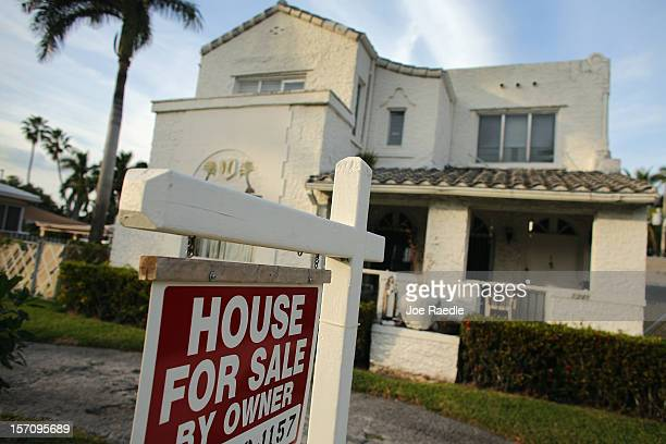 A 'For Sale' sign is posted in front of a house on November 28 2012 in Hollywood Florida According to SP Index reports for the month of September...