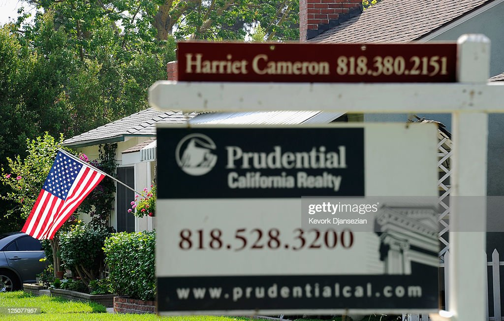 A for sale sign is posted in front of a house on September 15 2011 in Glendale California Foreclosures spiked as mortgage default notices filed by...