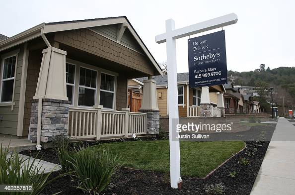 A for sale sign is posted in front of a newly built home on January 27 2015 in Novato California According to a Commerce Department report new home...