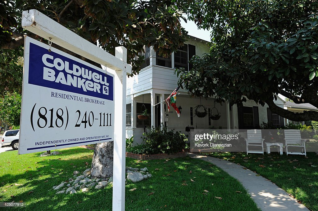 A for sale sign is posted in front of house on September 15 2011 in Glendale California Foreclosures spiked as mortgage default notices filed by...