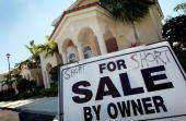 A for sale sign is seen in front of a home on April 24 2009 in Miami Florida New home sales in the United States dropped to a seasonally adjusted...