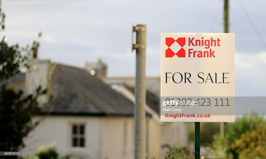 A for sale sign is seen outside a house in the picturesque seaside village of Bantham on November 13, 2013 in Devon, England. Evans Estates, which has owned the land, buildings and popular surfing beach for nearly 100 years, have decided to sell next spring and Bantham, complete with sandy beach, pubs, thatched houses and a quayside, plus surrounding Devonshire land is expected to go for 10 million GBP alone. However residents of the family-owned village, which nestles in the South Hams and has parts in a designated area of outstanding natural beauty, are concerned that the new owners may reverse the anti-commercialism ethos of the Evans Estate and that the natural and unspoilt spirit of the area could be in jeopardy.