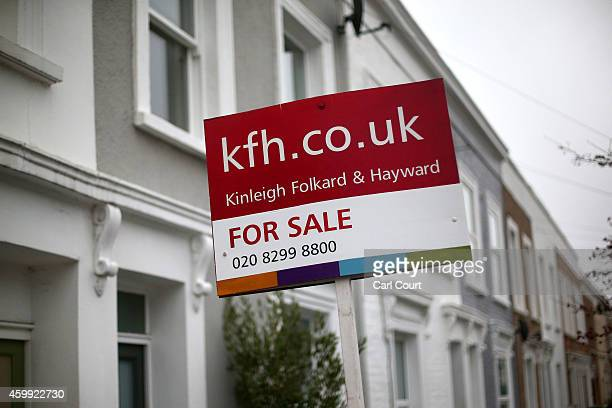 A 'for sale' sign is seen outside a property on December 4 2014 in in East Dulwich London England In his autumn statement Chancellor of the Exchequer...
