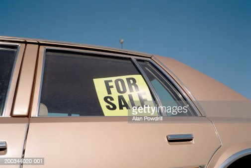 for sale sign placed in car window outdoors closeup stock photo getty images. Black Bedroom Furniture Sets. Home Design Ideas