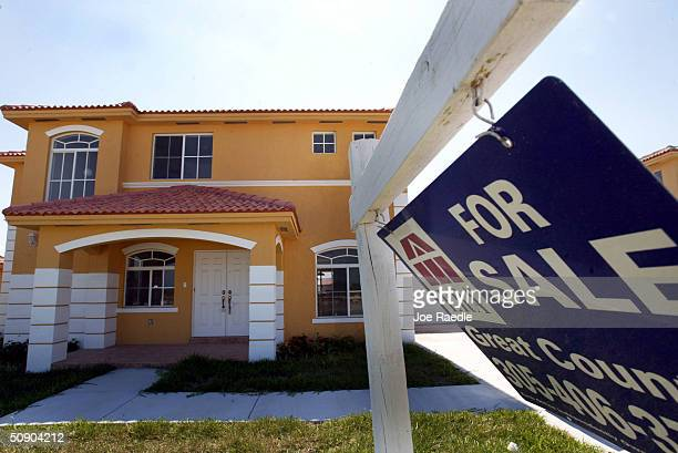 A 'For Sale' sign sits in front of a new home May 27 2004 in Miami Florida According to the Commerce Department new home sales in the United States...