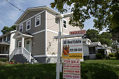 A 'For Sale' sign sits in the front yard of a house June 23 2015 in Northeast Washington DC Purchases of new homes in the US rose in May to the...