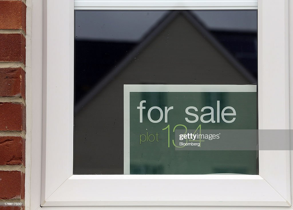 A 'For Sale' sign sits in the window of a newly constructed house at a Persimmon Plc residential building site in Romford, U.K., on Friday, Aug. 16, 2013. Persimmon, the largest homebuilder by market value, said in July that its operating margin widened to about 15 percent during the half from 12.1 percent. Photographer: Chris Ratcliffe/Bloomberg via Getty Images