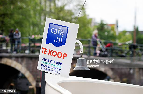A for sale sign sits on the bow of a houseboat in Amsterdam Netherlands on Wednesday Aug 26 2015 Seven years after a global financial crisis was...