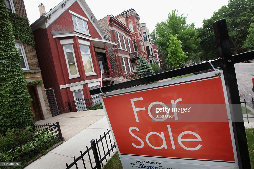 A 'For Sale' sign stands in front of a house on May 31, 2011 in Chicago, Illinois. According to the Standard & Poor's Case-Shiller Home Price Index home prices fell in March in 18 of the 20 metropolitan areas monitored by the index, reaching their lowest levels since the housing bubble burst in 2006. In Chicago, were nearly 30 percent of homes offered for sale are bank owned, prices have fallen 7.6 percent from a year ago.