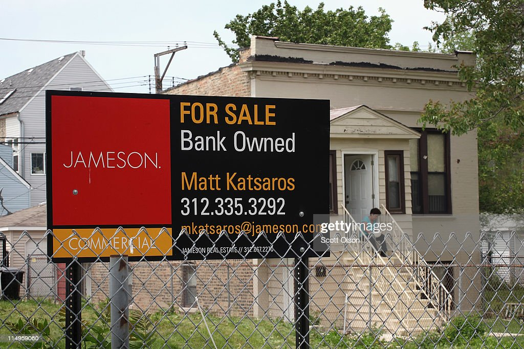 A 'For Sale' sign stands in front of a vacant lot May 31, 2011 in Chicago, Illinois. According to the Standard & Poor's Case-Shiller Home Price Index home prices fell in March in 18 of the 20 metropolitan areas monitored by the index, 12, including Chicago, reaching their lowest levels since the housing bubble burst in 2006. In Chicago, were nearly 30 percent of homes offered for sale are bank owned, prices have fallen 7.6 percent from a year ago, with condominium prices in the city falling at nearly twice the rate of single family homes over the past year.