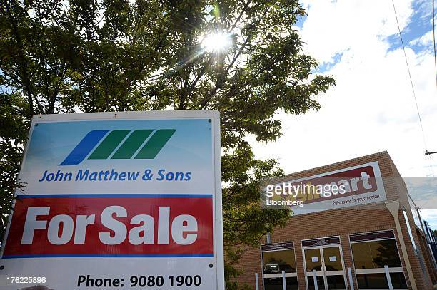 A 'For Sale' sign stands outside the closed KashMart pawn shop in the mining town of Kalgoorlie Australia on Thursday Aug 8 2013 Western Australia...