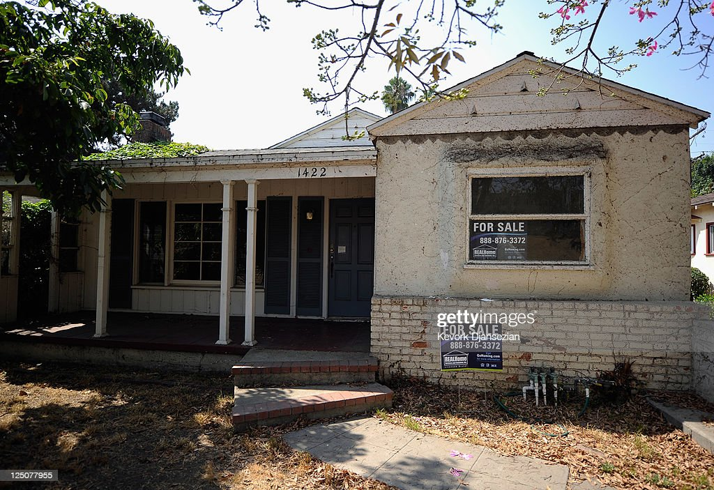 For sale signs are posted on a foreclosed house on September 15 2011 in Glendale California Foreclosures spiked as mortgage default notices filed by...