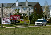 For sale signs stand on a medium strip in a housing development April 3 2007 in Chesapeake Beach Maryland Although the US stock market rose sharply...
