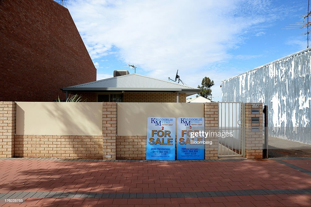 'For Sale' signs stand on display outside a residential property in the mining town of Kalgoorlie, Australia, on Thursday, Aug. 8, 2013. Western Australia, the nation's largest state by area with 2.6 million square kilometers (1 million square miles) of land, earned A$97 billion from minerals and energy sales in 2012, down from A$108 billion in 2011, according to government figures. Photographer: Carla Gottgens/Bloomberg via Getty Images