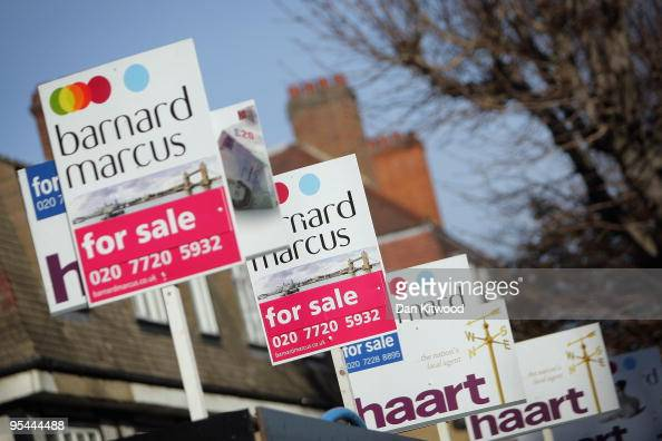 For sale signs stand outside properties on December 28 2009 in London England According to property website Hometrack the increase in house prices...