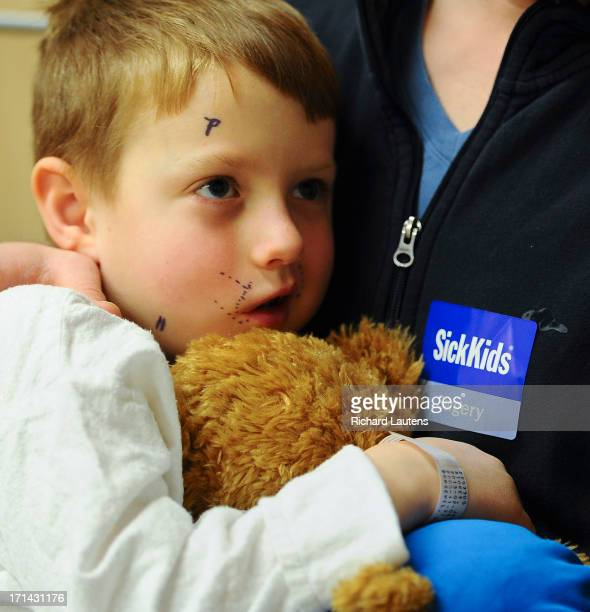 For Sick Kids Special Section Joshua waits on his dad's lap for surgery We followed Joshua Storey in last year's section as the boy who couldn't...