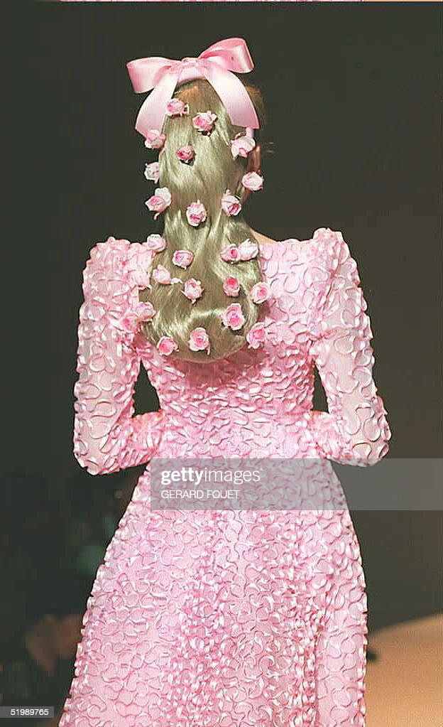 For the bride who never looks back Hubert Givenchy embroiders pink satin ruffles on a gown of pink tulle in the FallWinter 19951996 highfashion...