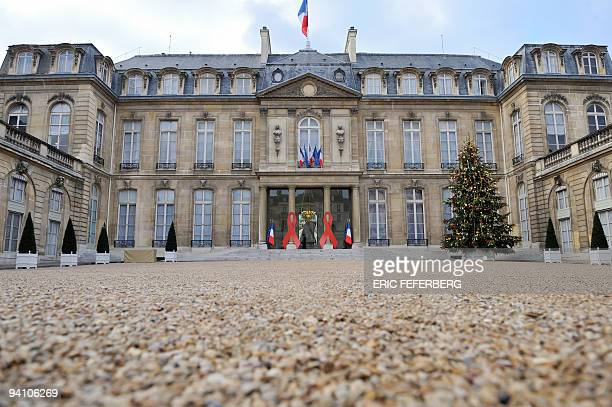 For the first time two large red ribbons are displayed on the columns of the Elysee presidential palace on December 1 2009 in Paris to mark World...