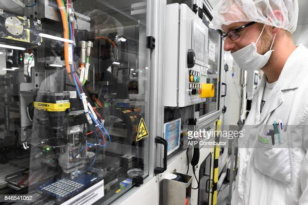 'Automobile between the thermal and the hybrid the 48 volts 'in full boom' An operator conducts an automaton of ceramic gluing in a clean room of the...