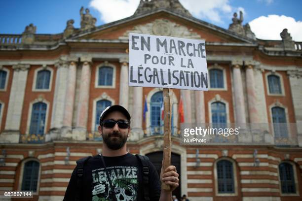 For the Global Marijuana March supporters of legalization for medical and recreationnal use run a stand on the main square of Toulouse the Capitole...