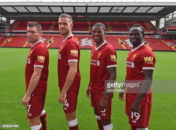 For the Launch of the Western Union partnership James Milner Jordan Henderson Georginio Wijnaldum and Sadio Mane of Liverpool wear the shirts with...