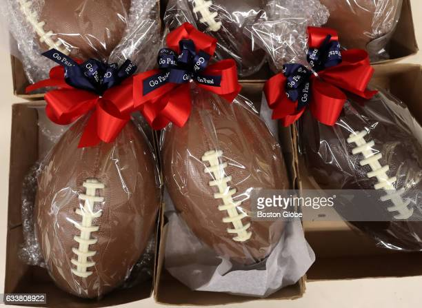 For the Super Bowl chocolatier Angela Ernst makes chocolate footballs each made out of more than two pounds of handmade chocolate with white...