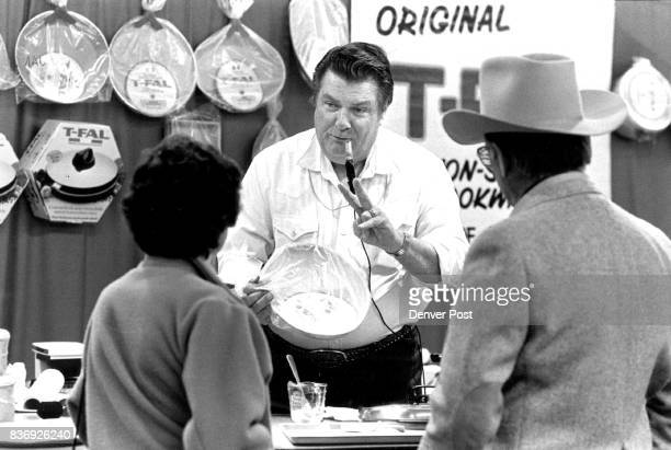 For the upscale beef eater French cookware Pitchman Bob Jackson of Amarillo Tex sells TFal cookware to a stockman and his wife Wednesday at the Stock...