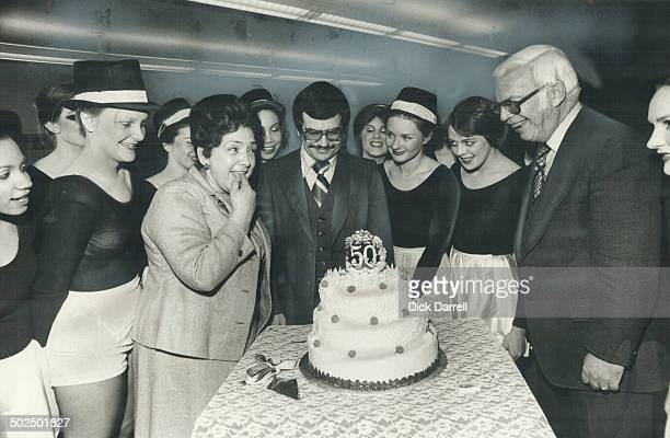 For these grads it's a piece of cake Ontario Minister of Labor Bette Stephenson tastes the icing on a cake celebrating the 50th anniversary of Earl...