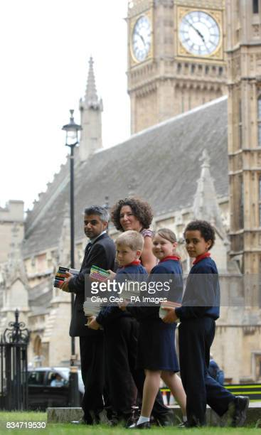MP for Tooting Sadiq Khan joins children from Wandsworth Primary School as they arrive at the House of Commons London with the childrens' suggestions...