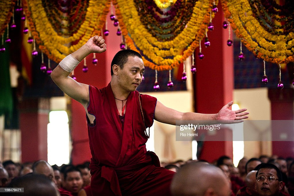 For two weeks 20,000 devotees from around the world attended the Jangchub Lamrim teachings given by His Holiness the Dalai Lama in Mundgod, Karnataka, southern India - here a monk from Dagpo Shedrup Ling monastery in the Himalayas debates in front of His Holiness in the Loseling temple..