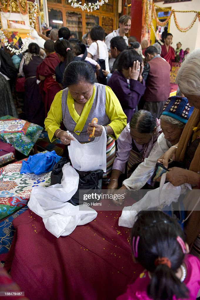For two weeks 20,000 devotees from around the world attended the Jangchub Lamrim teachings given by His Holiness the Dalai Lama in Mundgod, Karnataka, southern India - here devotees scramble for rice grains offered, hence blessed, by lamas during the final long life ceremony for His Holiness..