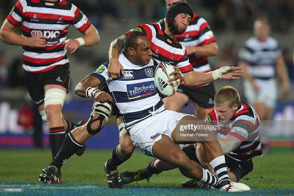 Forbes of Counties tackles Joe Rokocoko of Auckland during the round nine ITM Cup match between Auckland and Counties Manukau at Eden Park on August...
